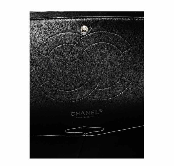 chanel jumbo classic flap bag black used logo