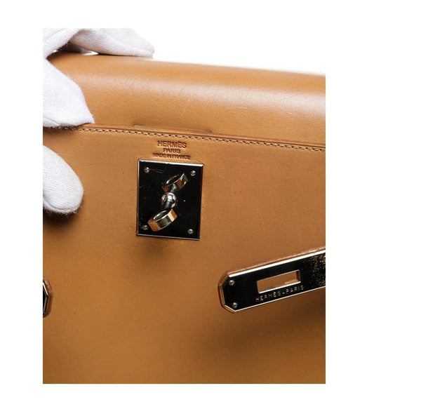 hermes kelly 32 gold used embossing
