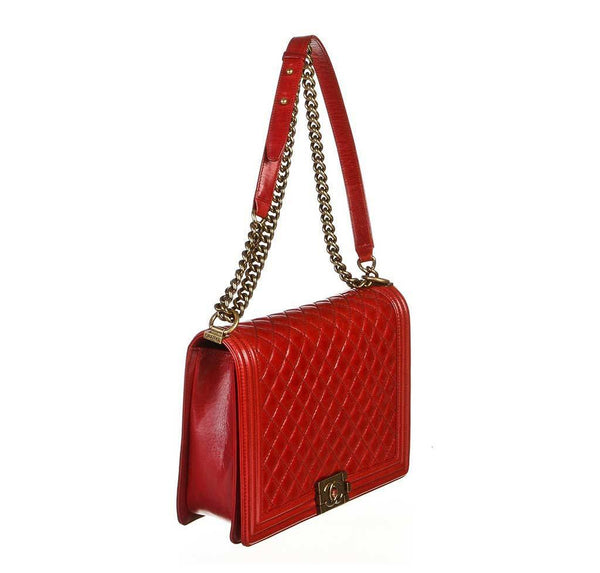 chanel quilted boy bag red used side