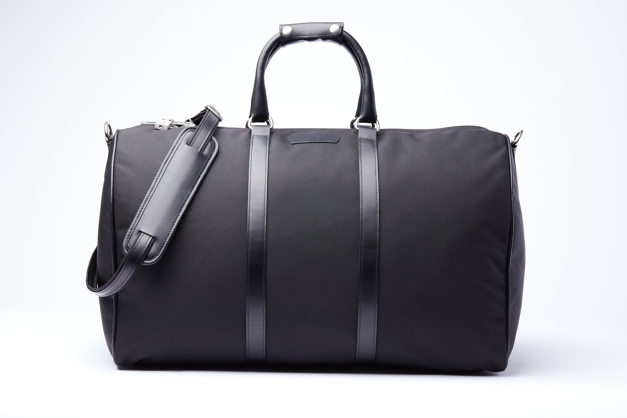 Black nylon and leather duffle bag