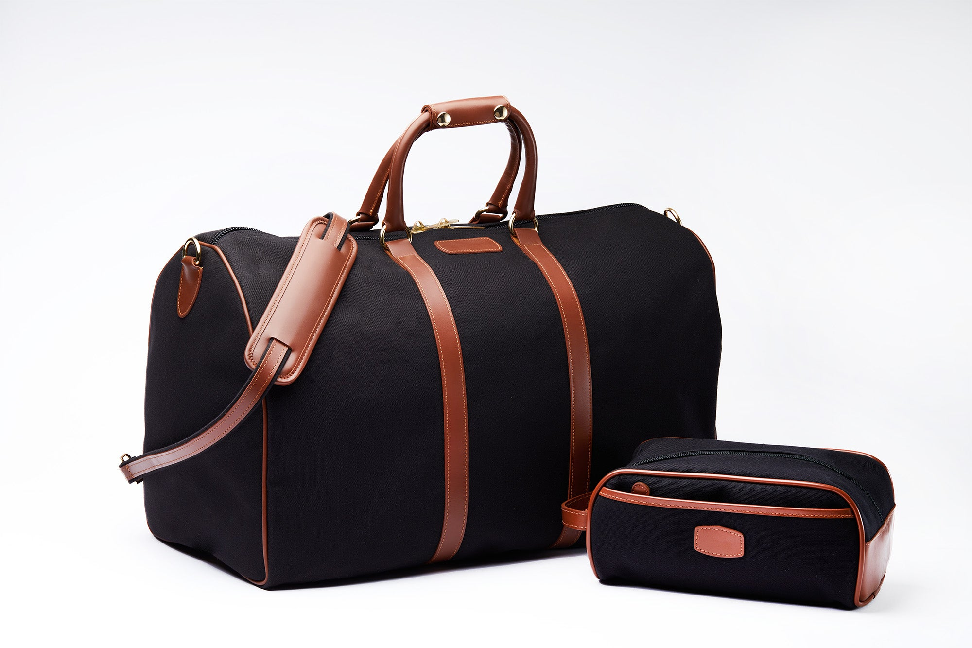 Black canvas duffle and shave kit with brown leather accents