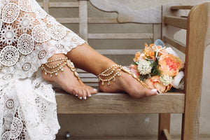 gold foot jewelry on a bride