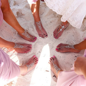 Girls wearing barefoot sandals on the beach