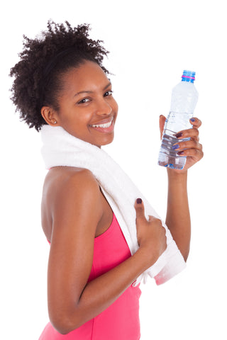 woman holding water bottle