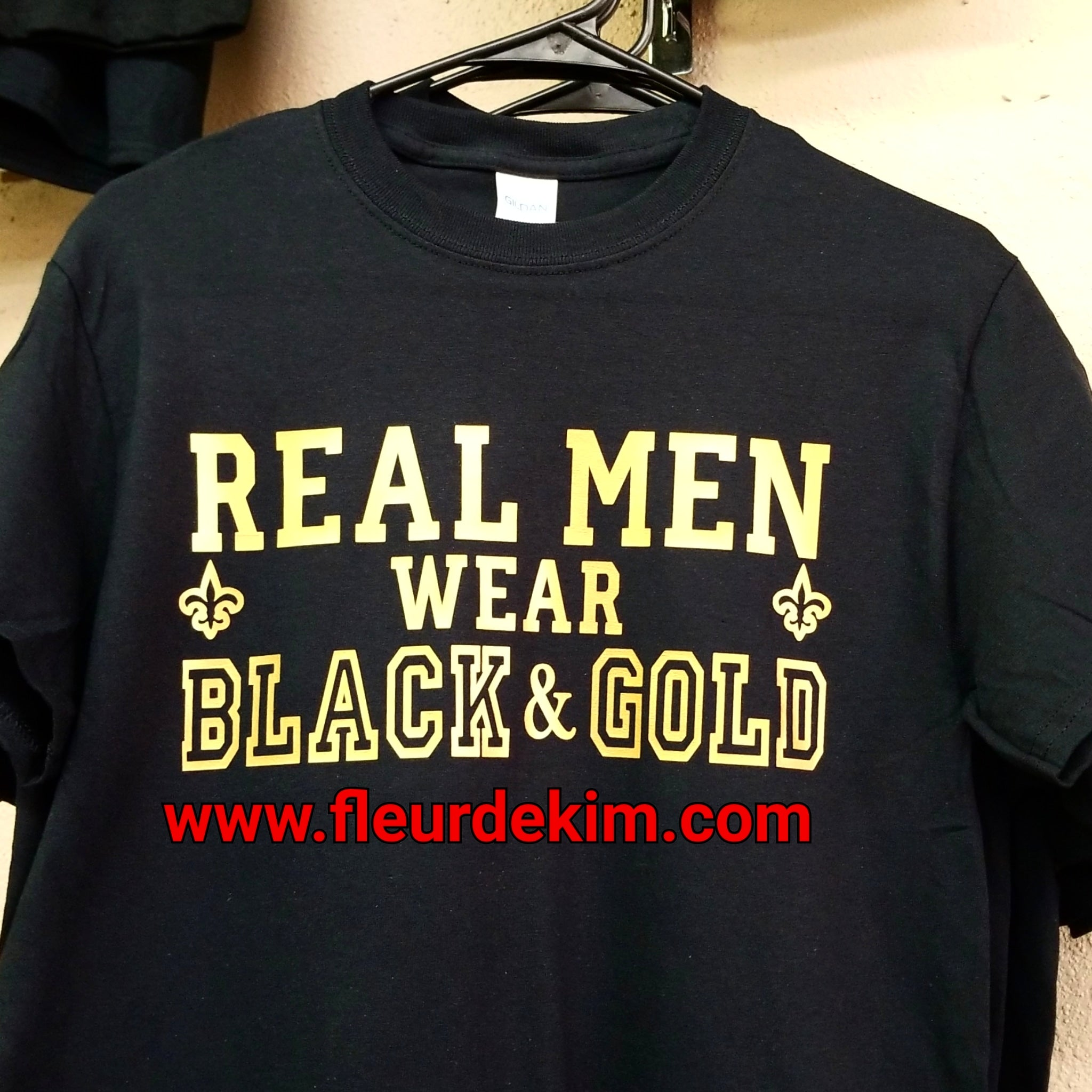"""Real Men"" wear black & gold tshirt"