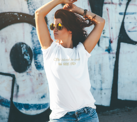 """She believed she could so she did."" Women's White Relaxed-Fit T-Shirt"