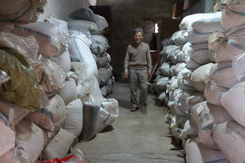 Master Chen in his warehouse