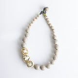 Aros Knot Necklace. Natural & Sand