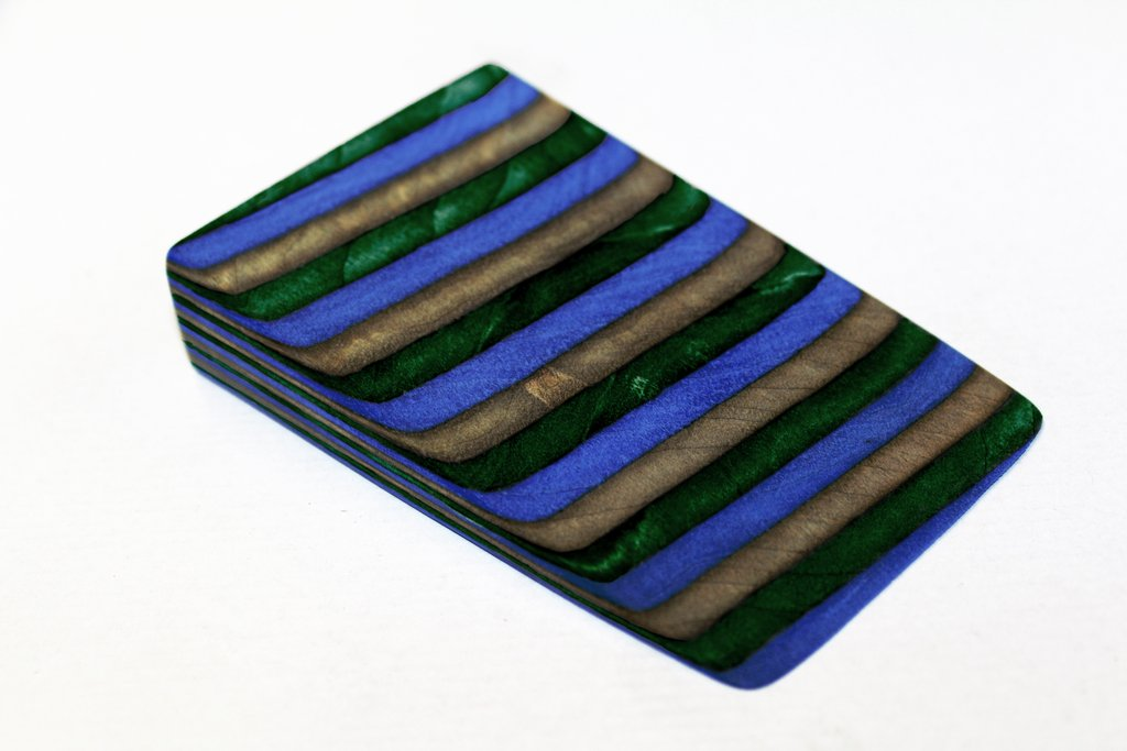 "3"" X 3"" X 12""  Coloured wood - blue, brown, green"