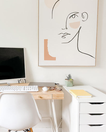 Neutral office space with a desk and computer