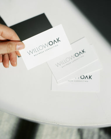 Willow Oak business cards placed on a bright white table