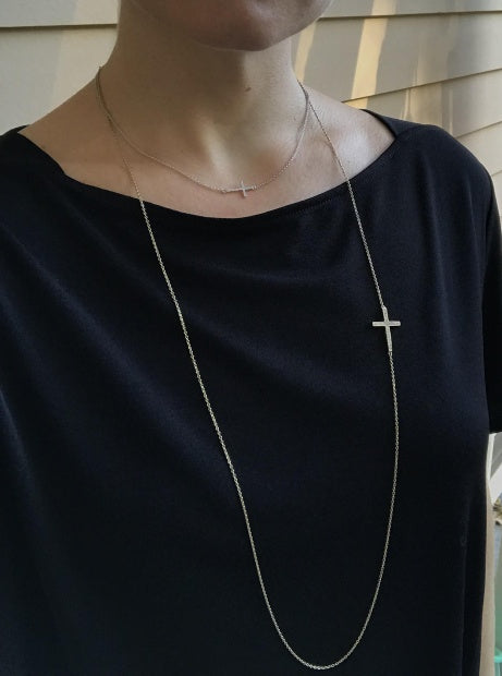 Sideways cross close to neck line shown with asymmetrical cross