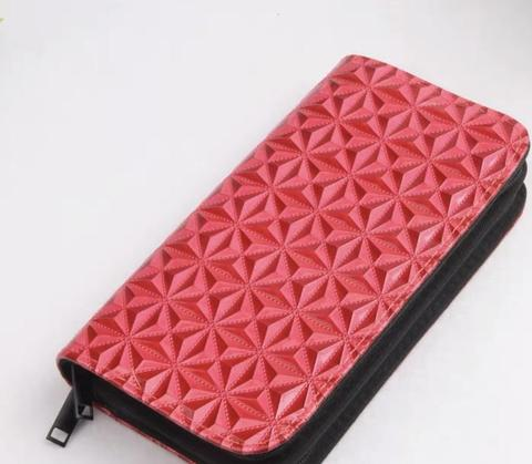 A pink hair scissor case for hairdressing shears