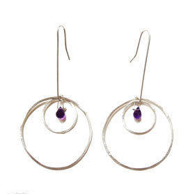 large and small open circle earrings with stone