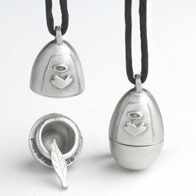 egg-shaped pewter pendant with stylized angel's wing carved on the front; a tiny pewter feather charm sits inside