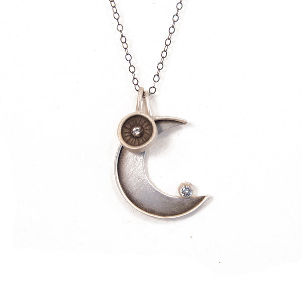 faceted crescent necklace with radiant circle