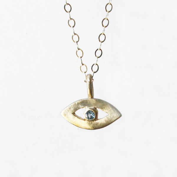 14k gold tiny eye amulet