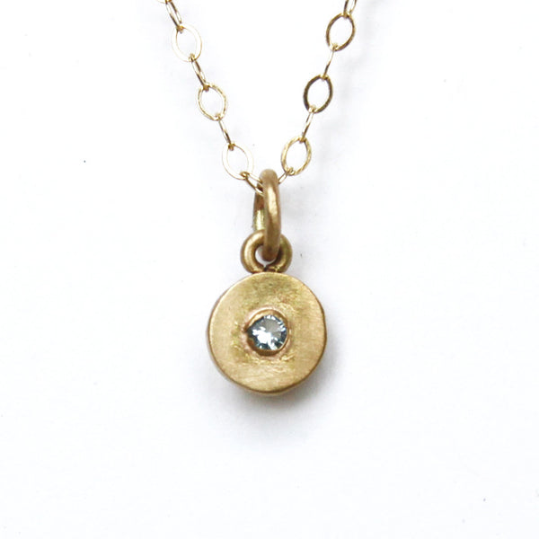tiny gold dot with faceted gem {starts at $150}