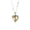 tiny gold heart with faceted gem