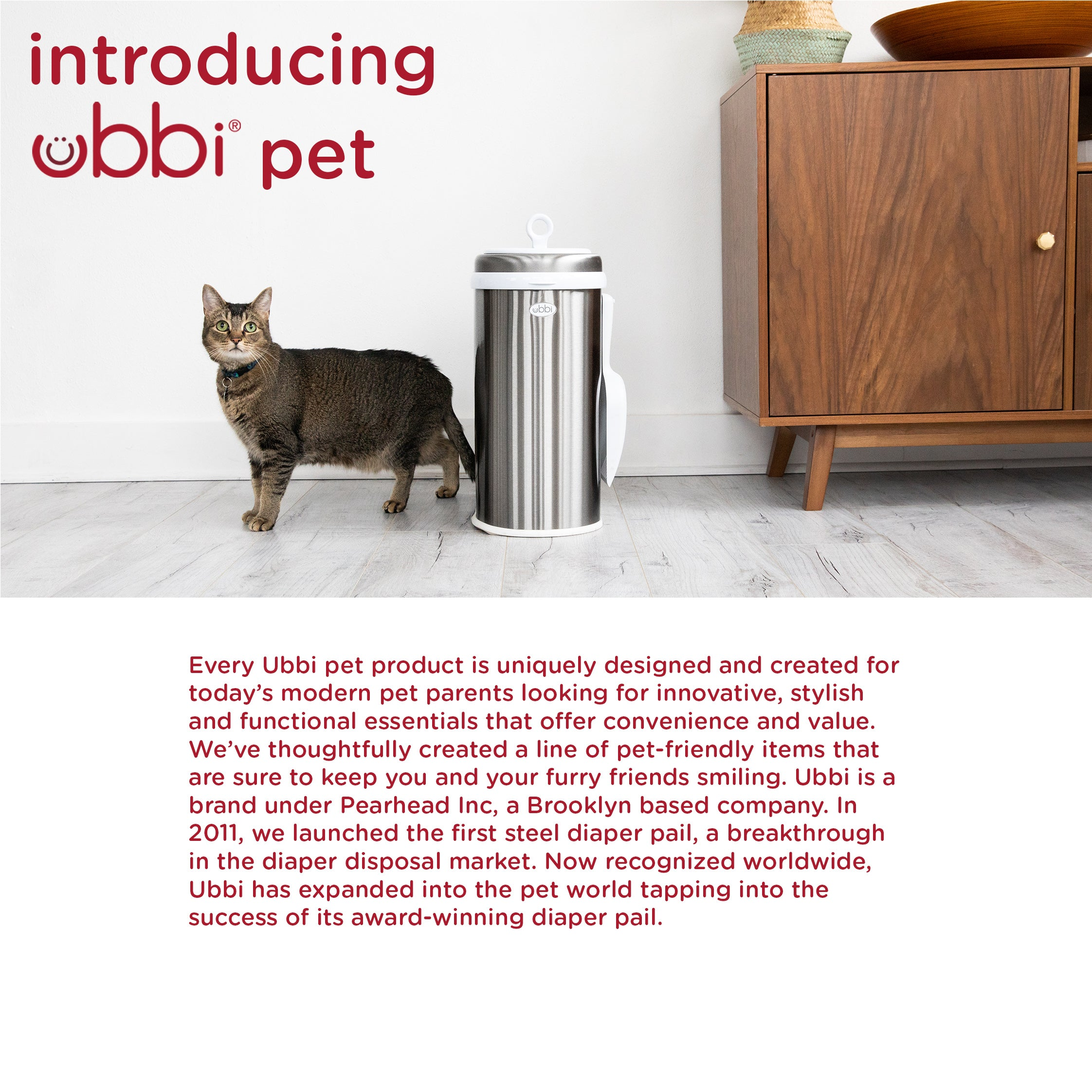 Closeup of the Ubbi on-the-go pet waste bag dispenser with a blurred dog in the background