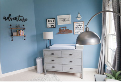 A FARMHOUSE NURSERY WITH A NOD TO TRAVEL
