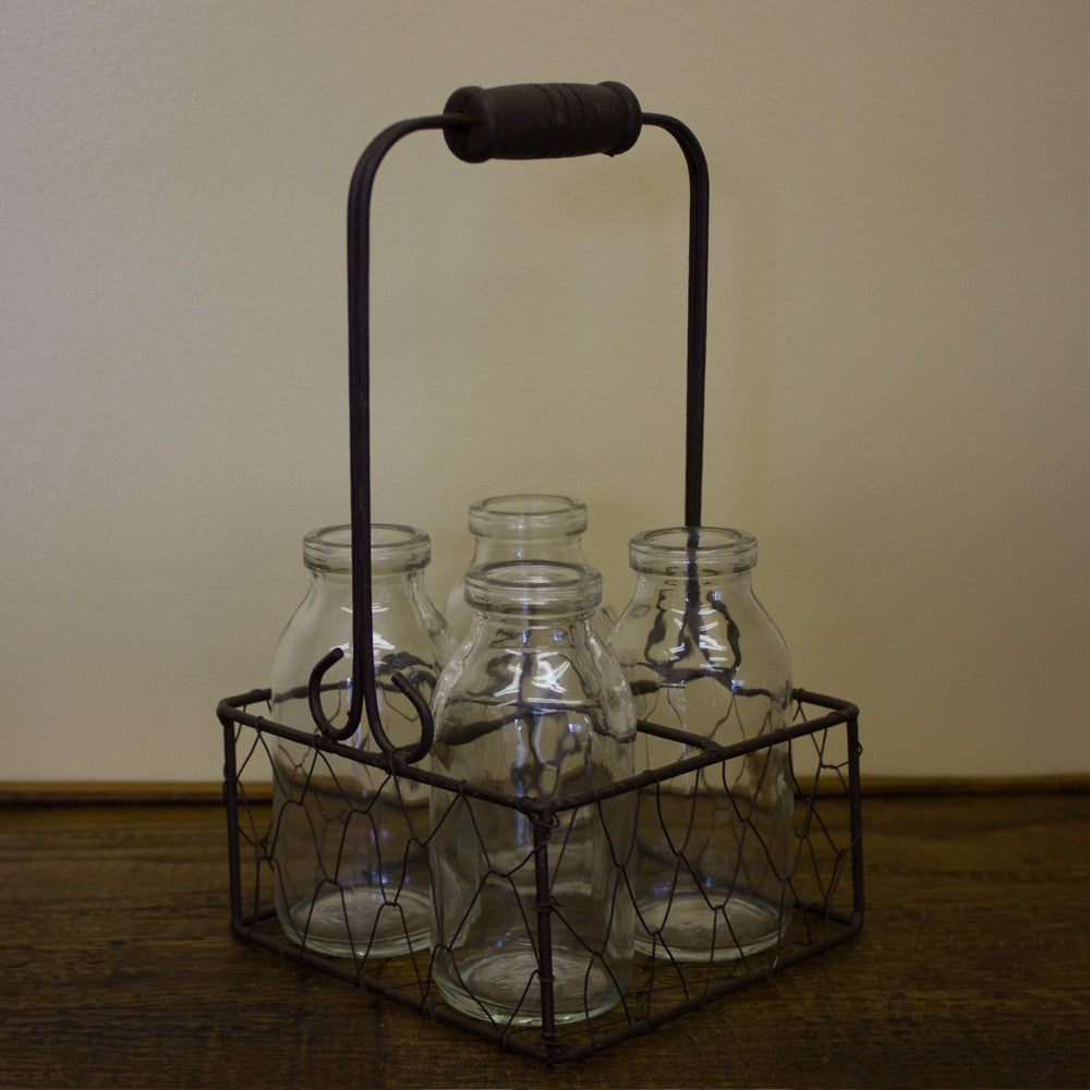 Four Glass Bottle Bud Vases in Wire Basket
