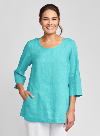 Back Up Tunic (shown in solid Teal), 3/4 sleeve linen top, back pleat detail with button down top, one angled front pocket, and a scoop neckline  100% Linen, FLAX Bold 2021