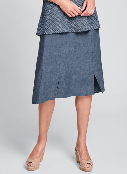Out Skirt (shown in Denim Yarn Dye), 100% Yarn-Dyed Linen, Knee-length skirt with pleats and hem slits, in Regular and Plus sizes.  FLAX Spring Traveler 2020.