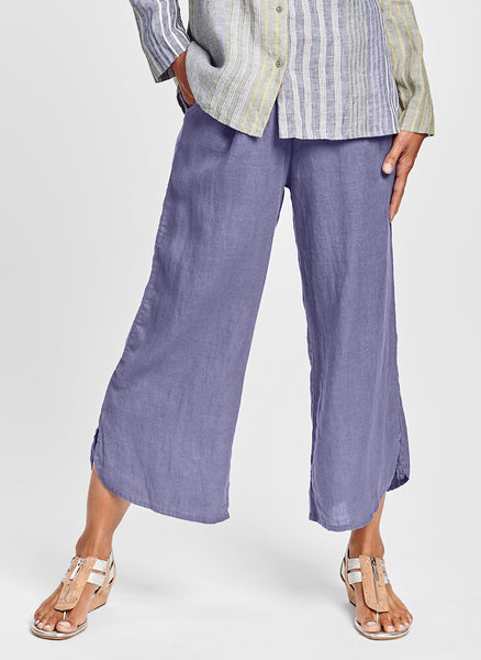 "Shirttail Floods (shown in Lilac) is a wide leg pant, woven in 100% Handkerchief-weight Linen, with a full elastic waist, and deep side seam pockets, finished with a fun and flirty shirttail hem and side slits that end just above the ankle, at ""Flood"" length. UnderFLAX 2021."