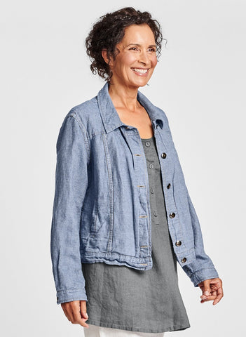 FLAX Jean Jacket (shown in Denim color), lightweight linen blend (53% Linen - 47% Cotton), collared with button front, long sleeves with button cuff, and pockets both inside and outside.  Available in 3 versatile colors.  Collection:  FLAX Additions 2021.