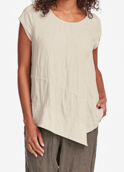 Cap Tee (shown in Almond, layered over the Metro Crop pant), cap-sleeved linen tee (100% Handkerchief-weight Linen, crinkled) with a round neckline, and soft cotton knit on the cap-sleeves and asymmetric hemline, landing on the hip in length.  Urban FLAX 2019, for womens regular and plus sizes.