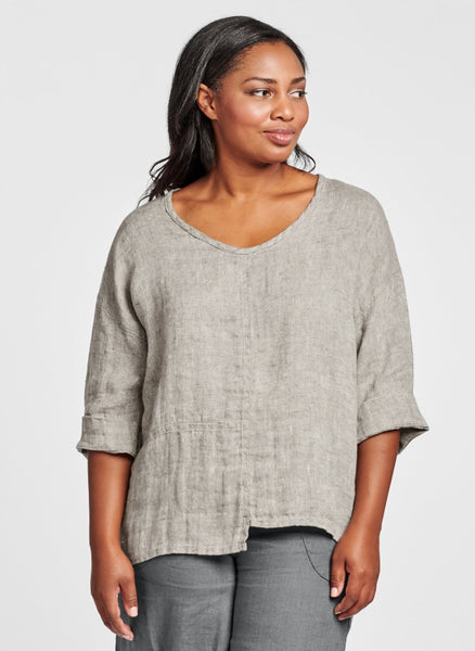 "Poet Top (shown in Castlerock Panama), a sophisticated linen pullover, with a wide rounded neckline, drop shoulders and wide 3/4 sleeves and cuff finish, woven with two-colored threads, for a ""sweater-like"" texture, featuring beautiful seam detailing and an asymmetric hemline. 100% Linen, in women's regular and plus sizes. Collection: FLAX Classics 2021."
