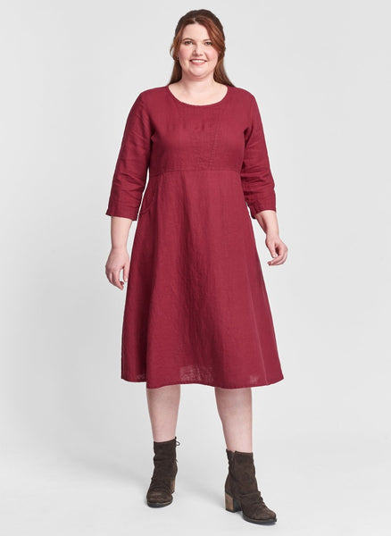 Dashing Dress (shown in solid Garnet), a mid-length linen dress, with 3/4 sleeves, a rounded neckline, an empire waist, and two side pockets, 100% Linen. Collection: FLAX Classics Two 2021.