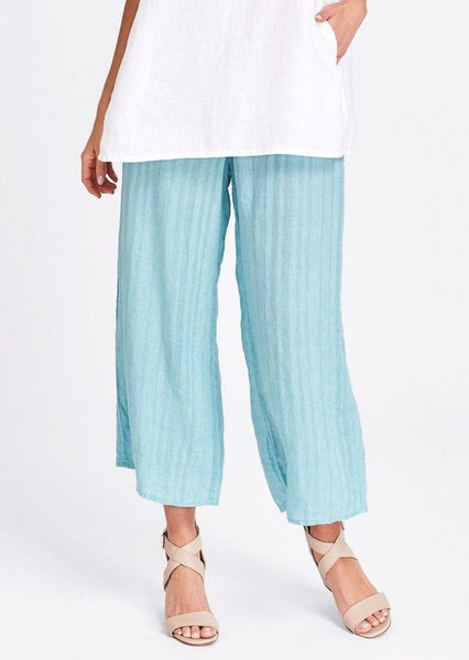 Sociable Floods (shown in Aqua Wave), 100% Lightweight Linen (woven in a tone-on-tone stripe design), Flat Front waistband, elastic in back, elegant wide legs, side seam pockets, ankle length (depending on your height), FLAX Sunshine 2018.