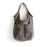 sale | waxed canvas sling | with or without outer pockets | two sizes