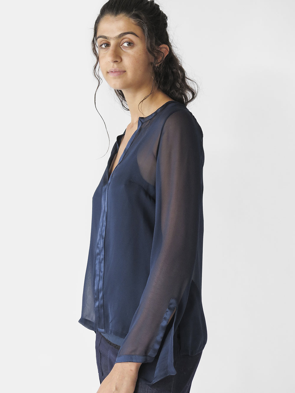 silk chiffon long sleeve Diego blouse with v-neck & charmeuse trim; has slits at sleeves and sideseam.