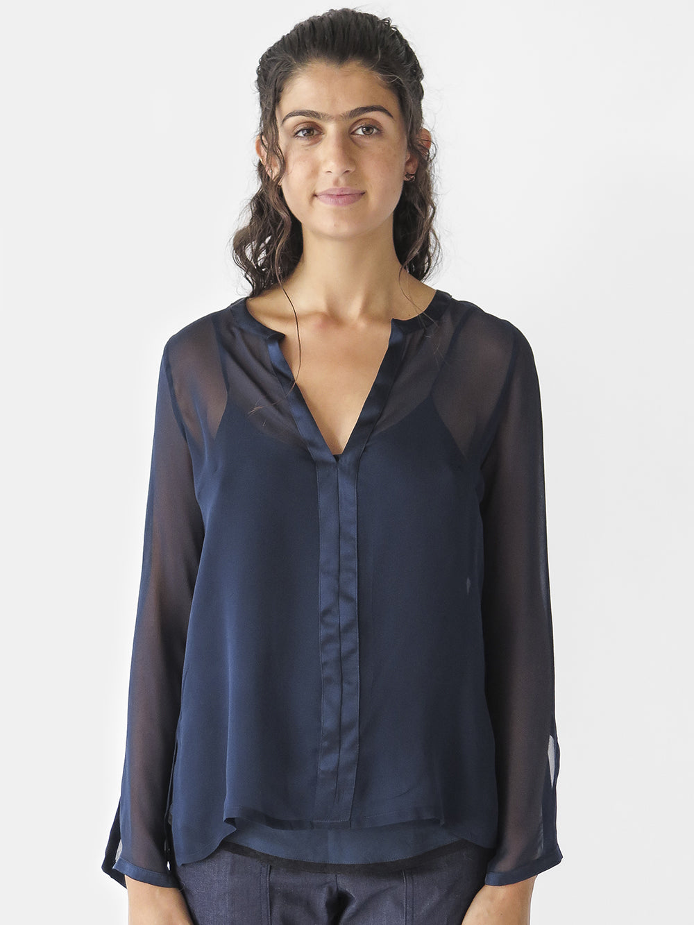 silk chiffon long sleeve Diego blouse with notched v-neck & silk charmeuse trim; has slits at sleeves and sideseam.