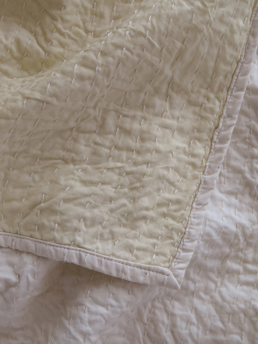 signature kantha quilt in white + natural