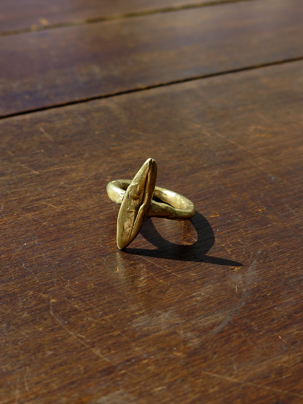 NN brass eclipse ring