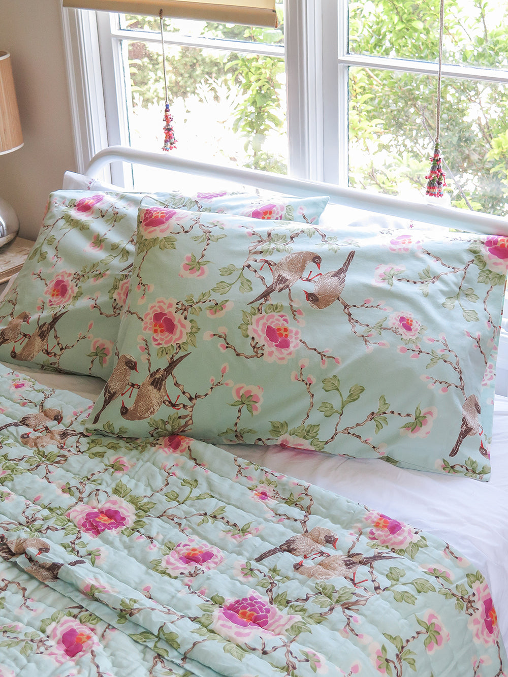 lovebird pillowcases in aqua