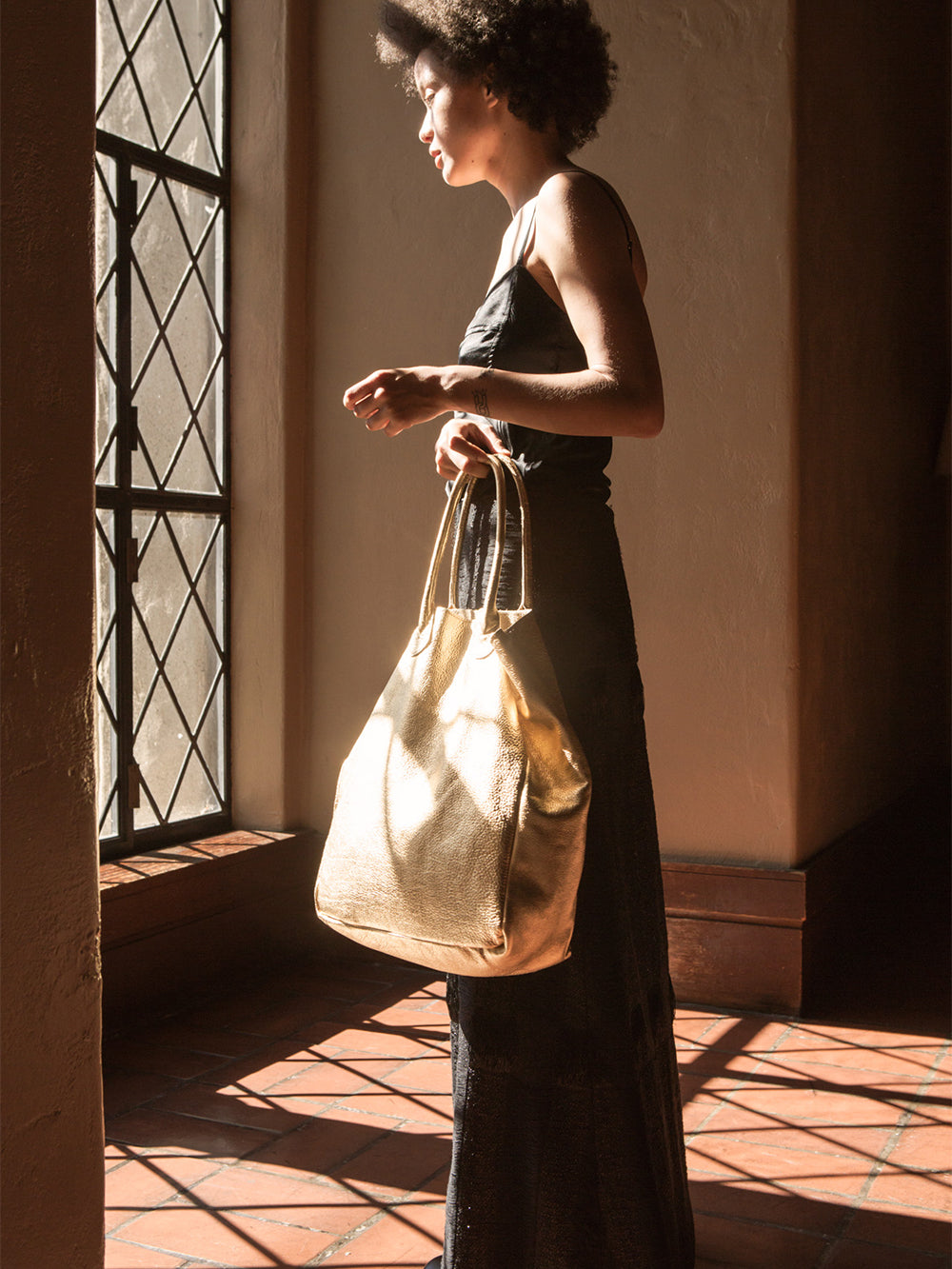 leather shopping tote in gold