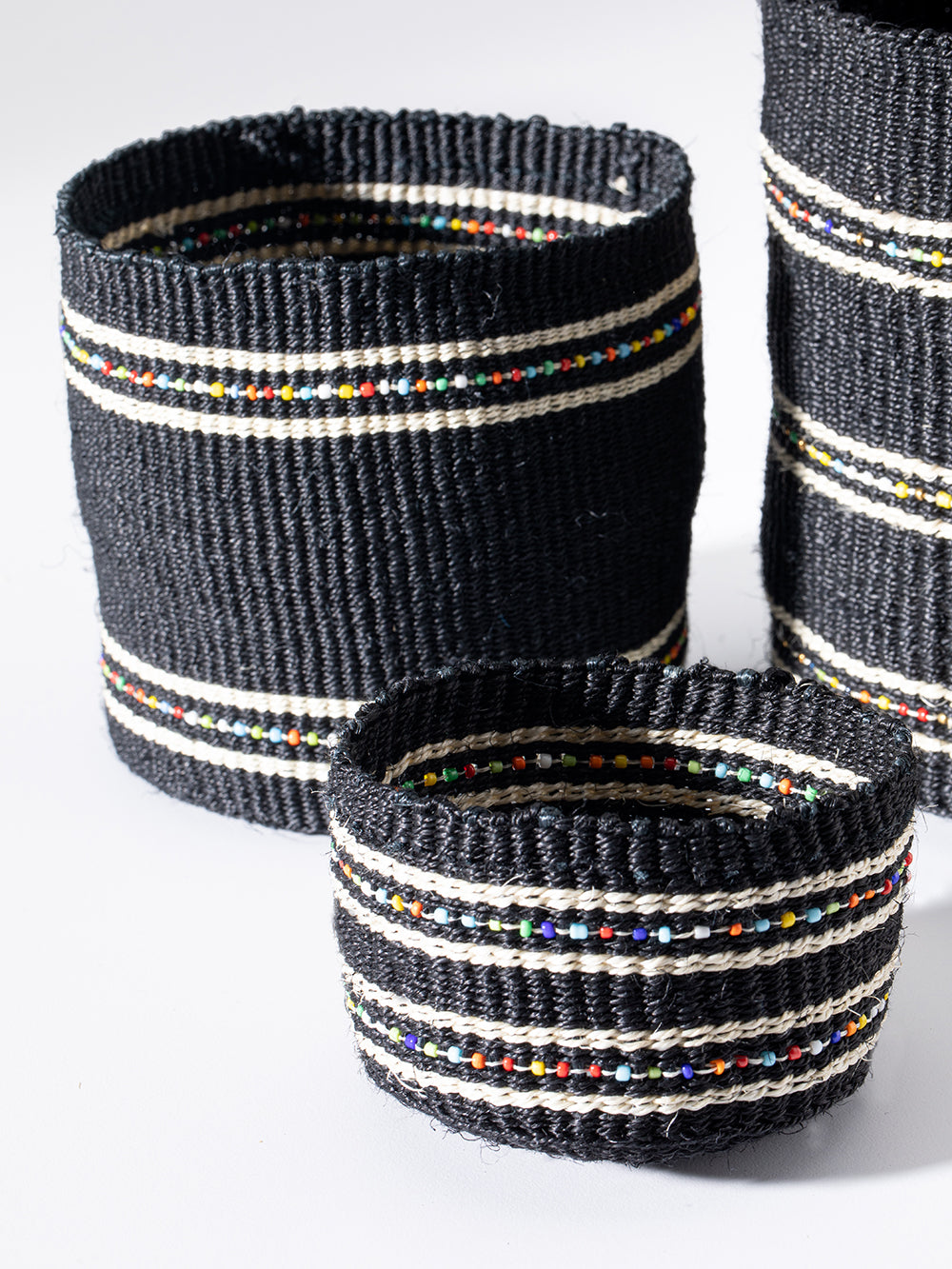 set of three beaded baskets