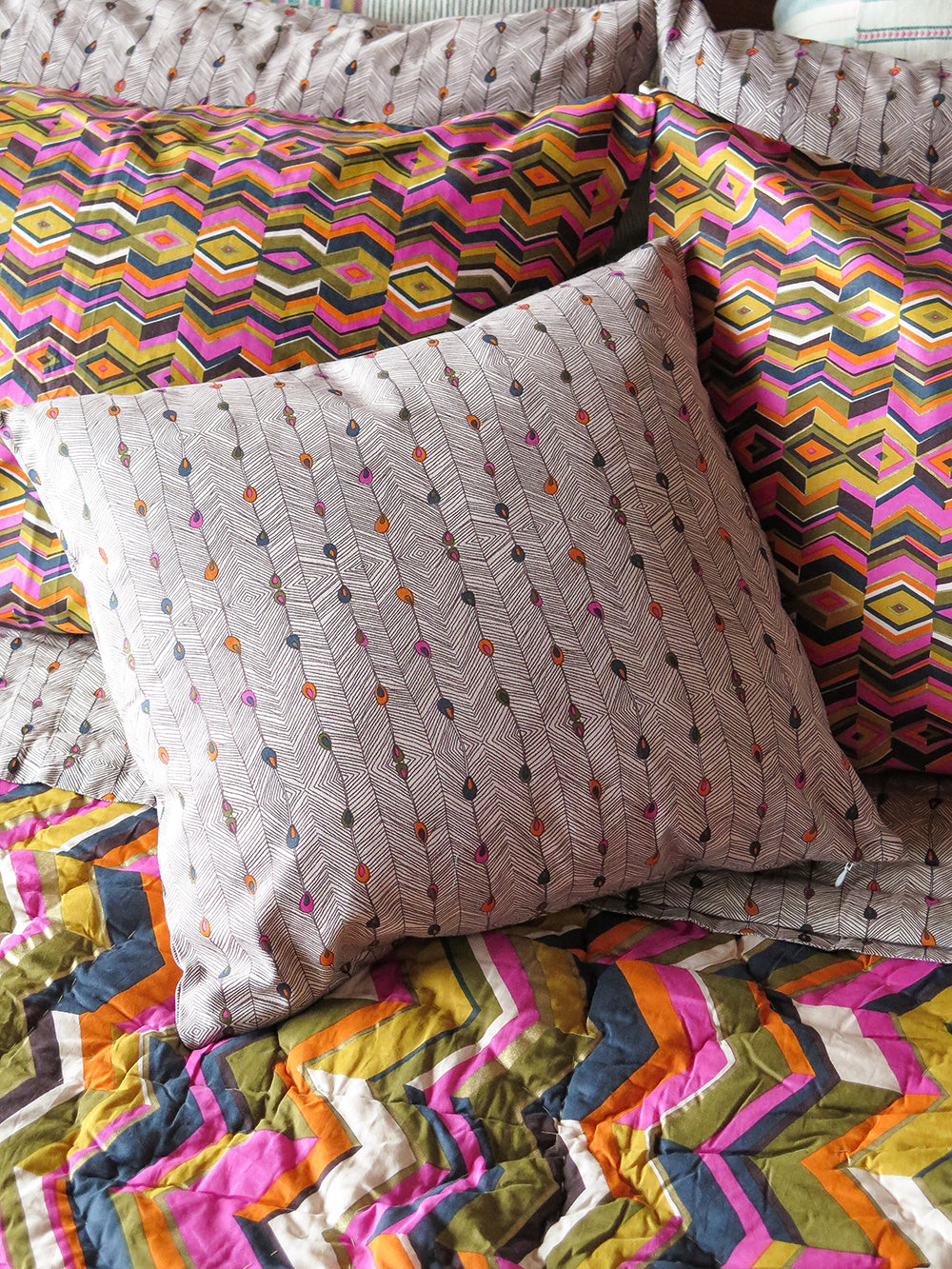 throw pillow in peacock stripe