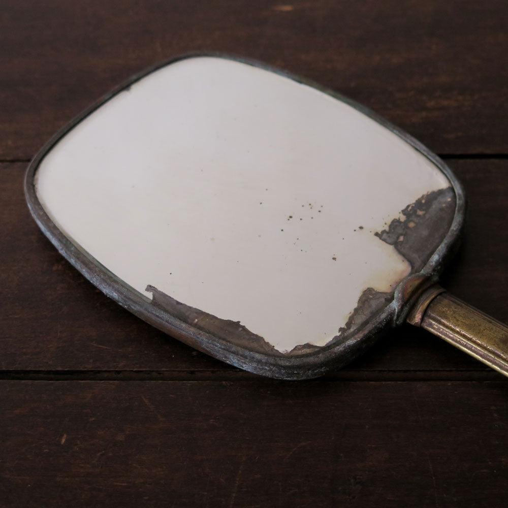enameled hand mirror