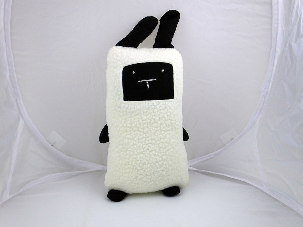 Handmade cuddly black & white sheep toy