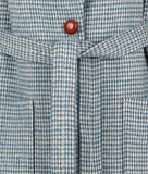 Close up of the TROY Dogtooth Wool Coat in Sea Green button and waist tie.
