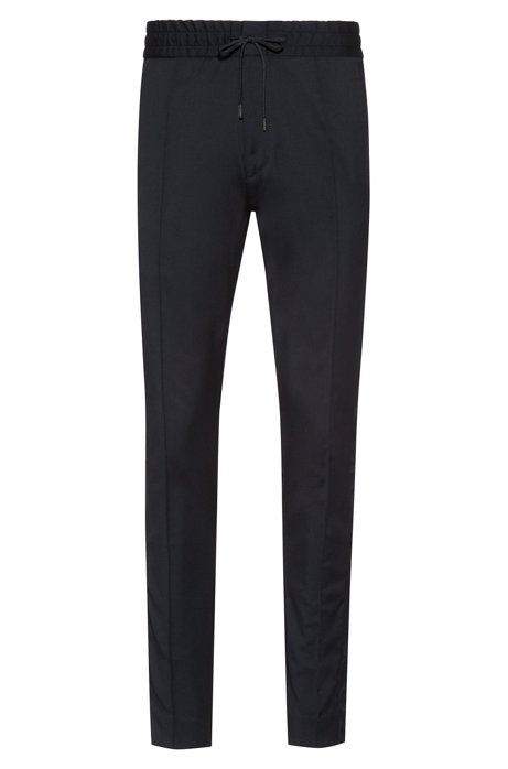 Virgin wool trousers with tapered fit and designer ribbon - Salon3o, Kooperativa GO-RE z.b.o., Tupaliče 15, 4205 Preddvor,Slovenia,Europe.All rights reserved.