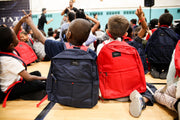 give backpacks to kids in need
