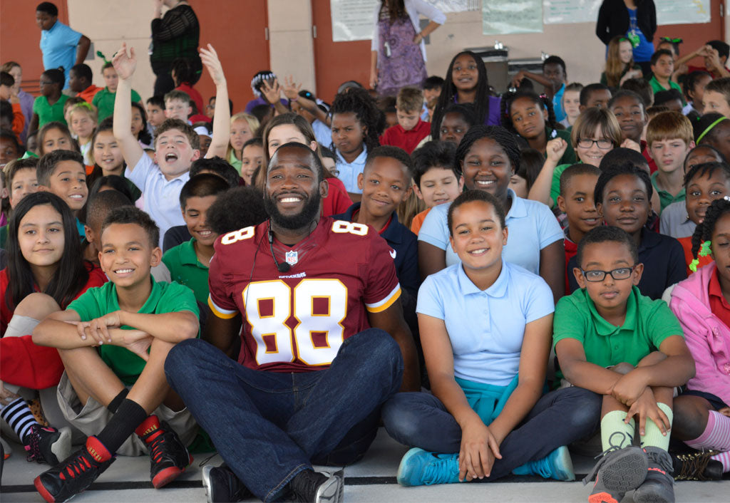 Football: Former John I. Leonard WR Pierre Garcon, now with Redskins, visits local elementary students | Pierre Garcon