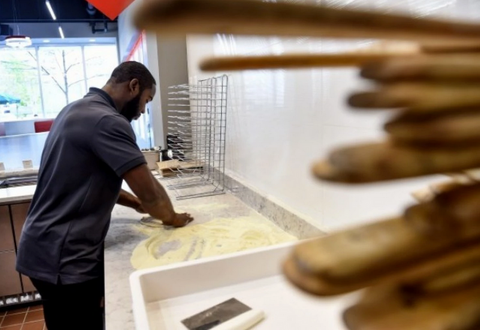 Pierre Garcon working at one of his Spinfire Pizza locations.